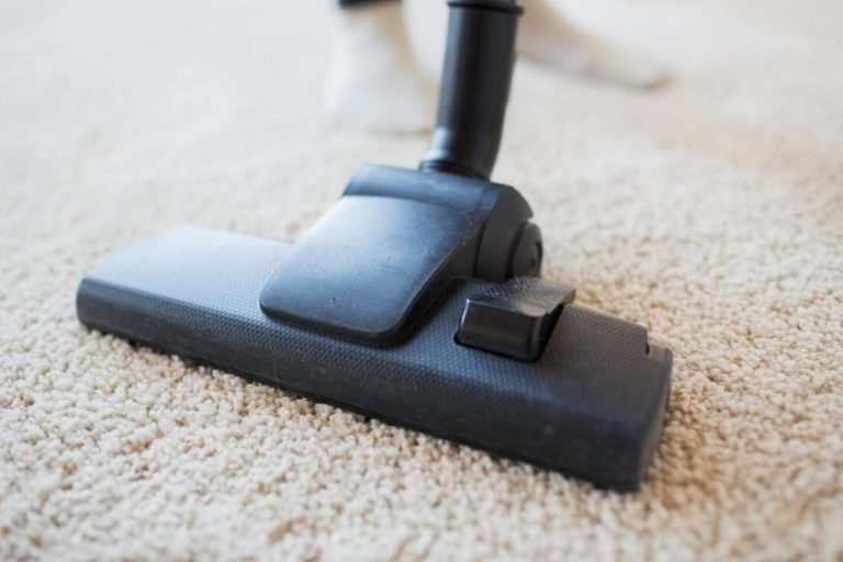 a picture of a carpet being cleaned by a vacuum cleaner
