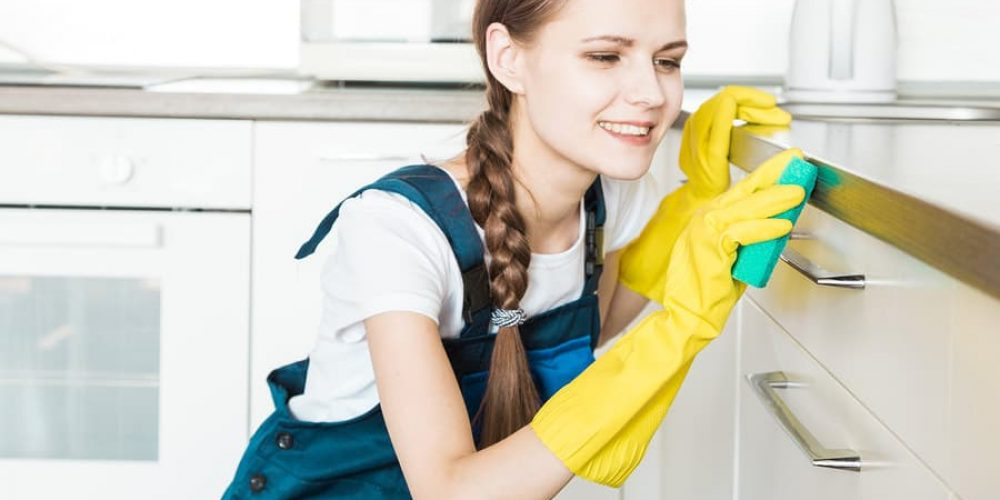 a picture of a girl cleaning a kitchen